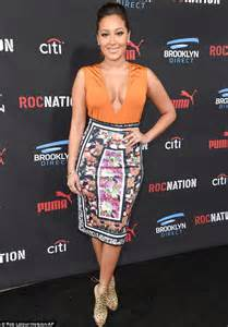 Adrienne bailon shows off more than just her diamond at pre grammy