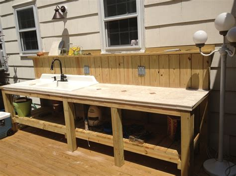 outdoor sink and countertop area complete with garbage