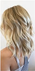 layered beachy medium length haircut all about blonde mane interest