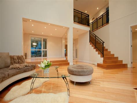 bi level living room ideas split level living room using black colours with floorboards floor to ceiling windows living