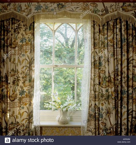 oriental drapes window of cottage with patterned oriental curtains and