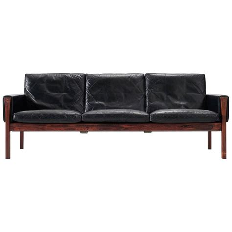 hans j wegner sofa in black leather and rosewood for sale