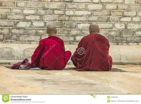 What Lies Beneath The Robes Are Buddhist Monasteries Suitable Places For Children Adele Two Monks Praying Editorial Stock Photo Image 34393553