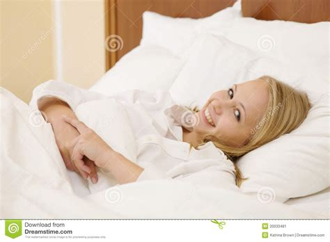 lying in my bed peaceful woman lying in bed resting at home stock image