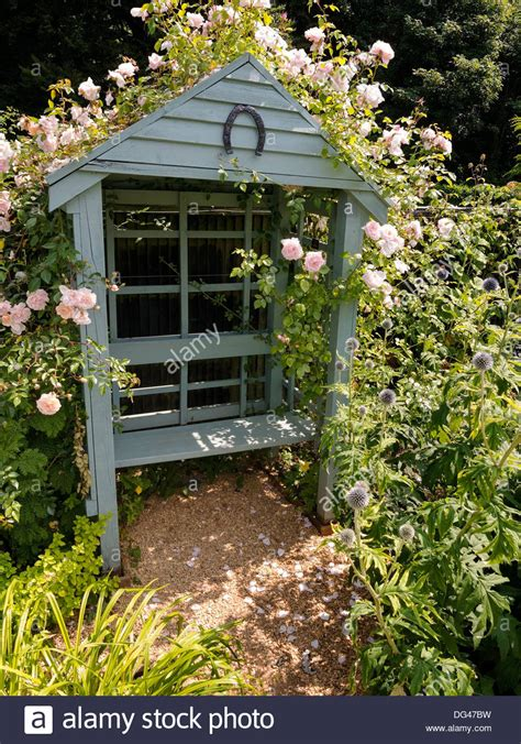 ornate garden bench ornate wooden garden arbor with bench seat and climbing roses in stock photo royalty