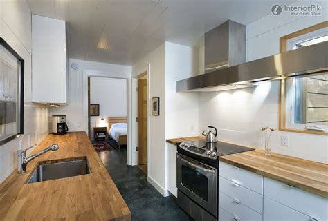 rectangular kitchen design رخامة خشب باللون البني بالمطبخ المستطيل المرسال
