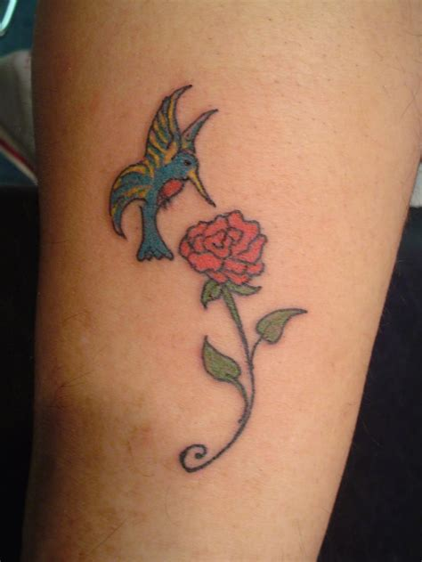 hummingbird and rose tattoo i like the but with the hummingbird