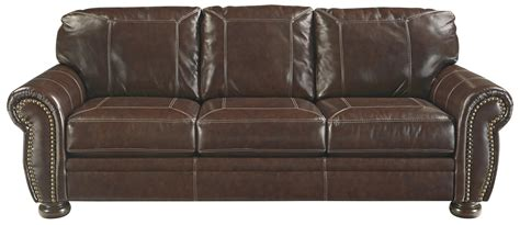 traditional leather match sofa with rolled arms nailhead