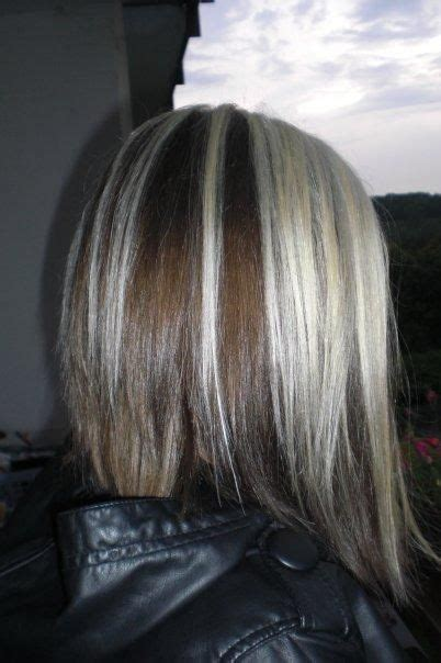 long angled bob only i would want it slightly longer in long brown angled bob with blonde chunks hair