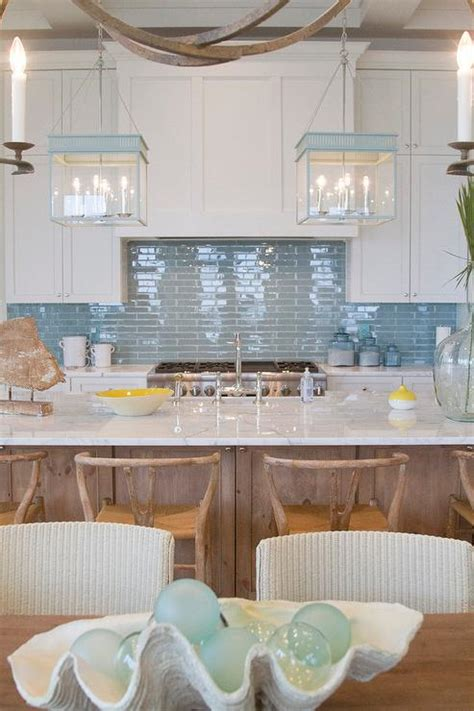 kitchen with blue backsplash and blue lanterns cottage kitchen