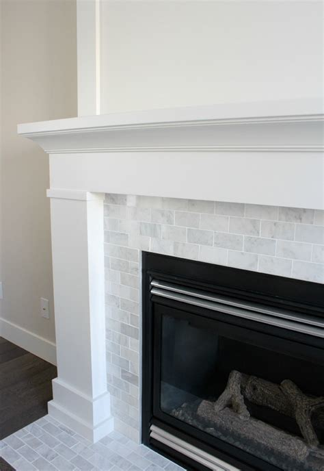 marble subway tile fireplace surround white marble fireplace the makeover details paint