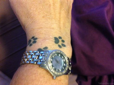 footprint tattoos on wrist 35 pretty paw print tattoos for wrist