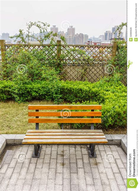 garden bench with roof a wooden bench in a garden on the roof terrace stock photo