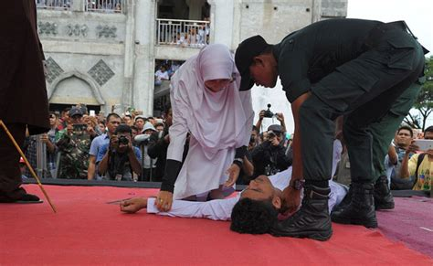 malaysian state amends law   public caning