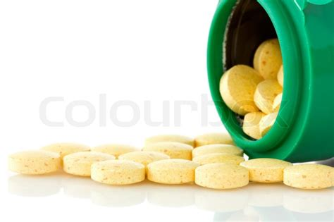 Noros Antioxidan Kaplet pill bottle with yellow pills stock photo colourbox