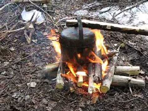 low fire cooking style simple pot hanger under tarp youtube