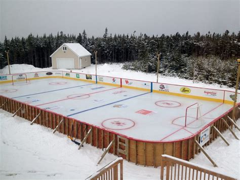 father creates backyard hockey rink for charity in support