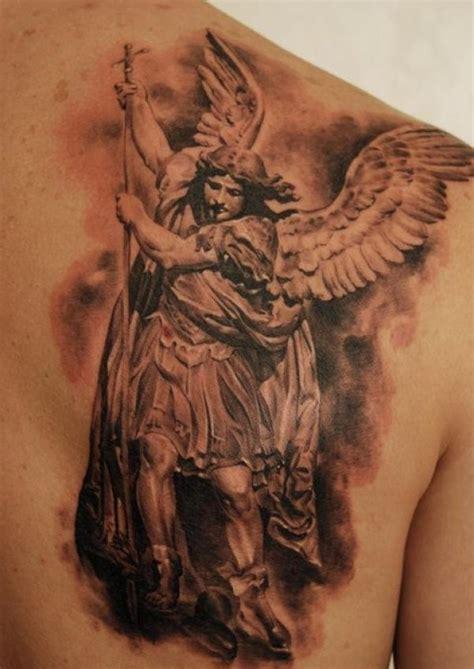 angel with spear tattoo on shoulder blade tattooimages biz
