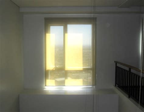 Blinds For Ceiling Windows by Sunscreen Roller Blinds Installed In High Ceiling Windows