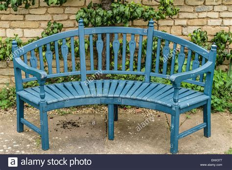 wooden garden seats and benches blue wooden garden bench seat in front of old stone wall
