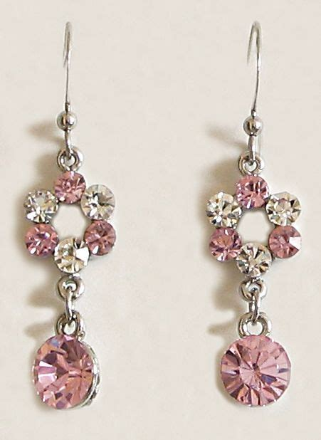 miki studed white ear pink mesmerize pink and white studded earrings