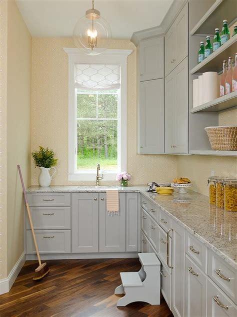 gray kitchen pantry cabinets  gray granite countertops