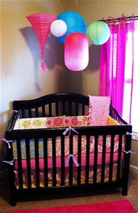 quilt inspired baby girl nursery design with colorful lanterns