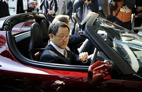 elon musk japan toyota chief showcases friendship with tesla sfgate