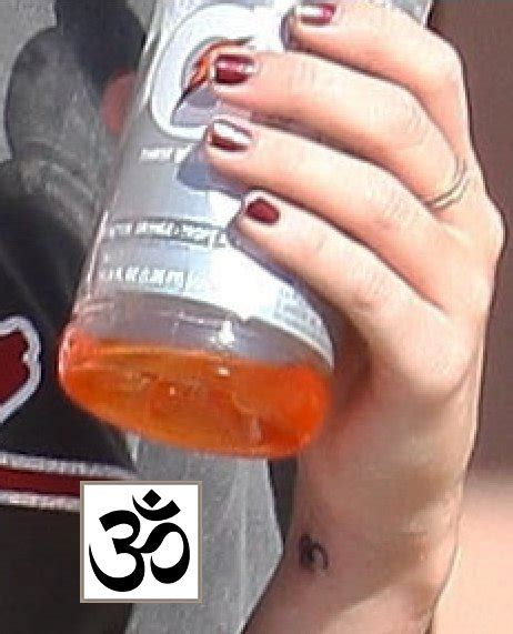 miley cyrus wrist tattoo miley cyrus om on wrist meaning story of
