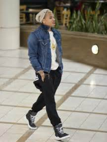 No germany switzerland chris brown lands at lax in a funky outfit