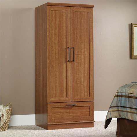 sauder armoire wardrobe homeplus wardrobe armoire in sienna oak finish 411802