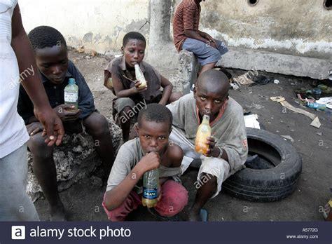 St Kid painet jb1334 kenya mombasa sniffing glue africa drugs stock photo royalty free