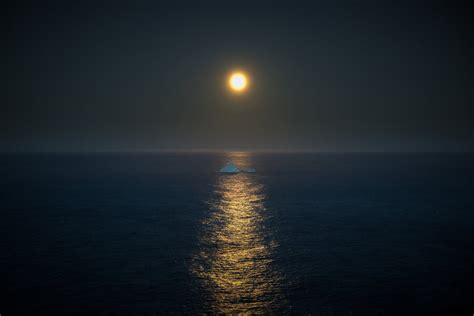 iceberg full moon mirror reflection light horizon sea gray