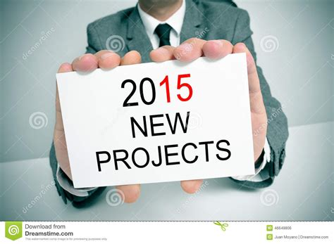 Recent Projects   man in suit with a signboard with the text 2015 new