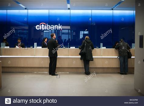 Citi Bank Teller teller stations in the citibank new flagship high tech branch in the stock photo royalty free