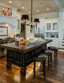 lights above kitchen island coastal home with traditional interiors home bunch