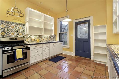 yellow kitchen backsplash ideas kitchen idea of the day mexican style kitchen with yellow walls ornate tile backsplash and