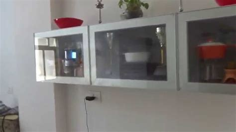 high gloss ss silver kitchen with profile and glass