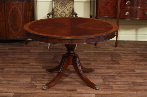mahogany dining room table 48 quot round to 66 quot oval mahogany dining table reproduction