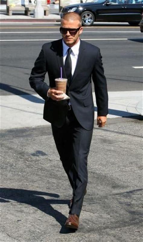 black suit brown shoes and buzz cut fame