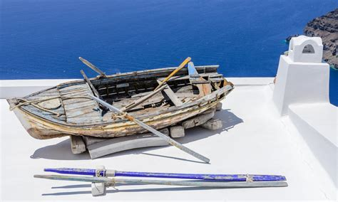 types of boats rowing file rowing boat on a house roof fira santorini