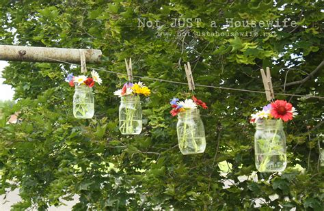 how to decorate my backyard for a party flowers on the clothes line stacy risenmay