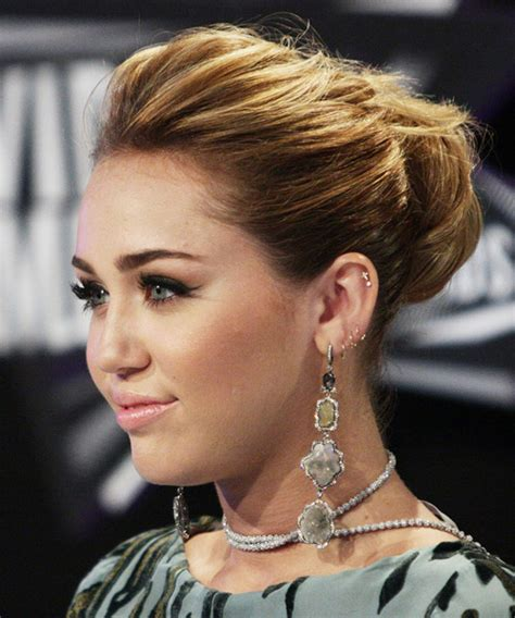 miley cyrus curly formal updo hairstyle medium brunette hair color
