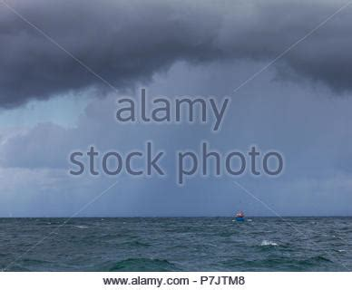 fishing boat caught in storm fishing boat caught in storm the perfect storm 2000 stock