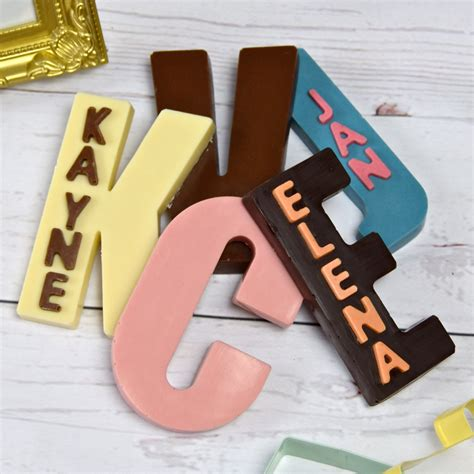 up letter to chocolate chocolate initials chocolate letters