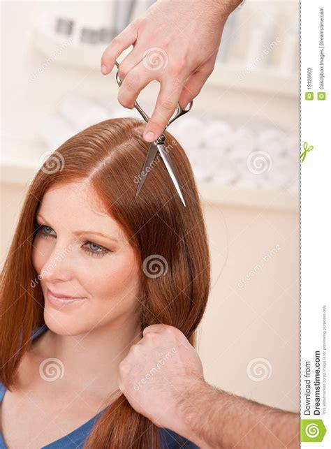 woman scissor cut hair styles professional hairdresser cut with scissors stock photos
