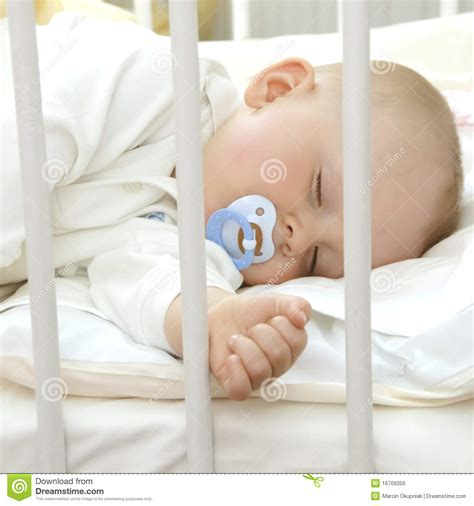 how to make baby crib more comfortable sleeping with pacifier royalty free stock image image