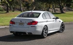 2013 bmw m5 rear three quarters photo 2