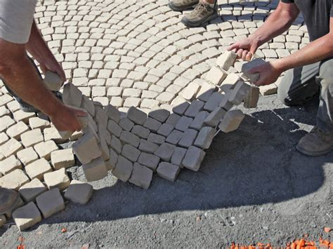 Laying Paver Patio How To Install A Patio Walkway How Tos Diy