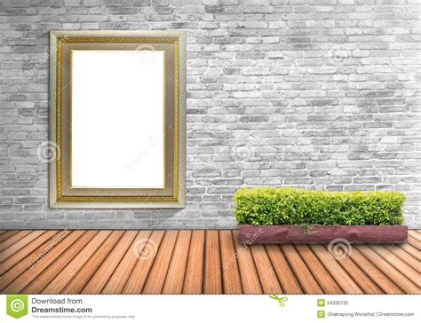blank frame vintage on a concrete wall with tree pot on